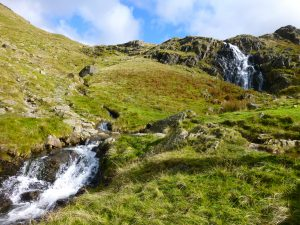 Walking the Coast to Coast - path crossing waterfalls